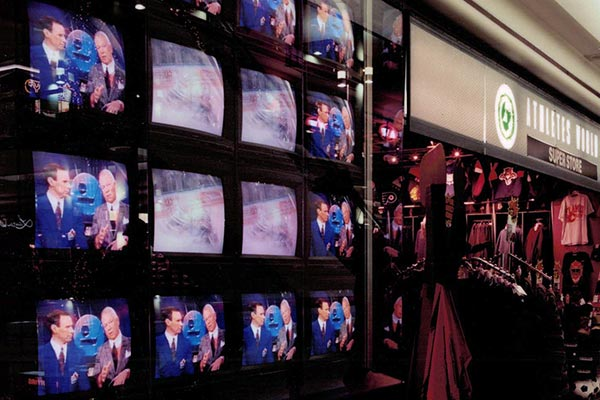 Wall of televisions in a 1990s Athlete's World - past projects by Peter J's General Contracting